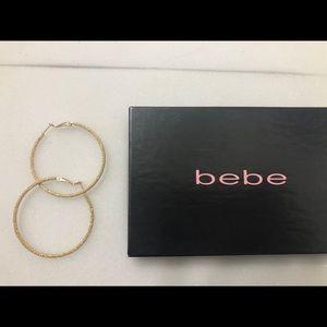 Bebe gold sparkle hoop earrings
